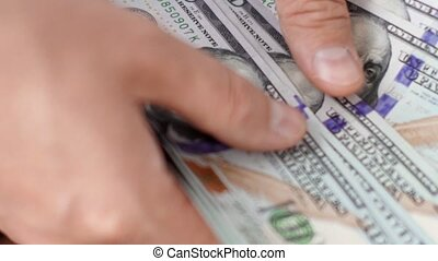 Male hands counting money cash in office close-up