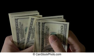 Male Hands Counting Money, One Hundred Dollar Bills on...
