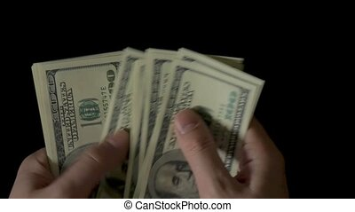 Male Hands Counting Money, One Hundred Dollar Bills on black