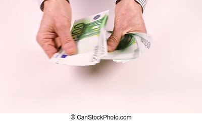 Male hands counting money with a face value of 100 Euros and...