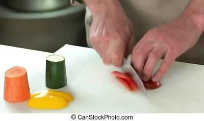 Male hands cutting paprika.