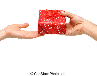 male hands give a christmas present with red ribbon to female hands.