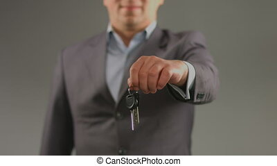 """Male hands hold keys. Renting car, apartment, real estate agent"""