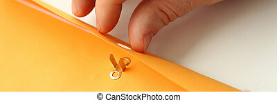Male hands holding envelope with important information