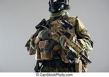 Male hands keeping assault carbine