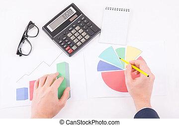 Male hands making segment calculations.