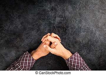 Male hands on dark background