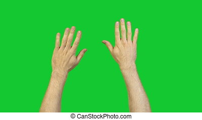 Male hands on green background