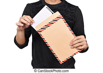 Male hands opening brown envelope