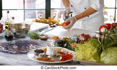 Male hands peel carrot. Man cooking food at table. Fresh...