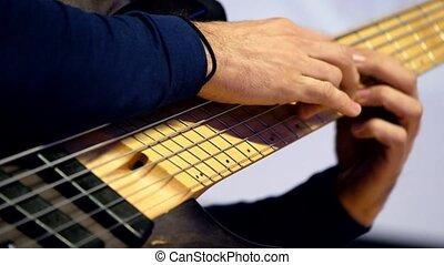Male hands playing guitar macro