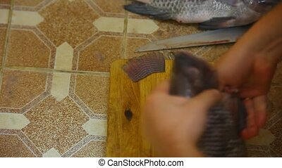 male hands purified from fish guts and washed in water pressure. Time lapse video speed up