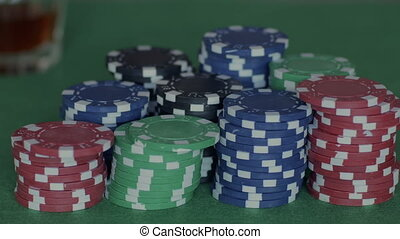 Male hands reaching towards pile of chips