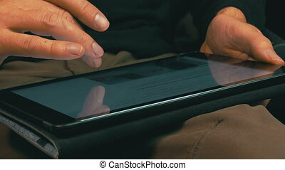 Male Hands Scrolling on a Tablet Computer