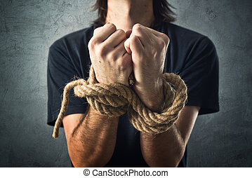 Male hands tied with a rope. Captivity concept.