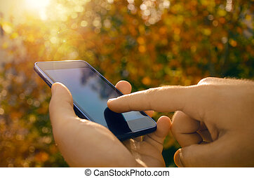 Male hands using a smart phone