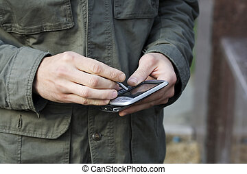Male hands using smartphone - Close up of male hands using a...