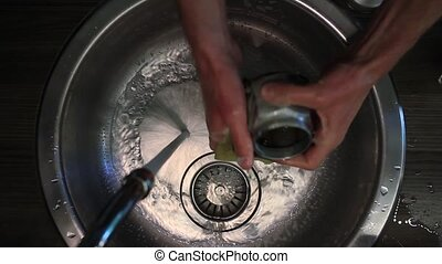 Male hands wash coffee maker in a sink top view HD