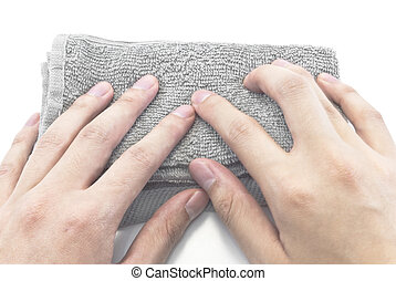 male hands wiping with grey rag