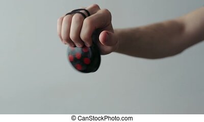 Male Hands with Castanets Beat the Rhythm.
