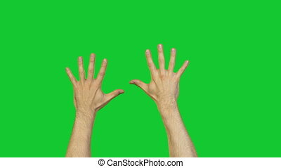 Male hands with fingers on green background