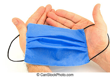 Male hands with hygienic mask
