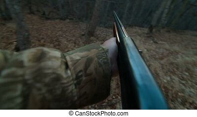 Male Hands With Shotgun In The Woods