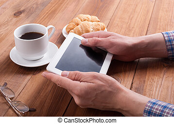 Male hands with tablet computer.