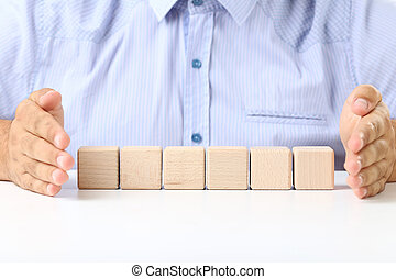 Male hands with the wooden cubes