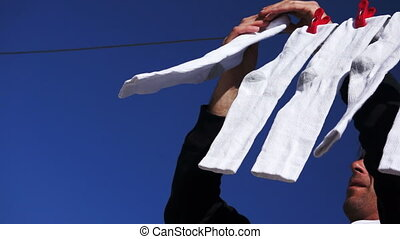 Male Hanging Socks to Dry