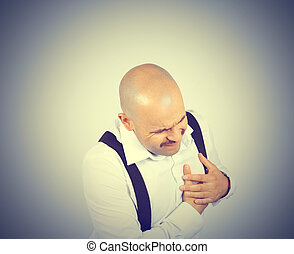 Male heart pain. The bald man with a mustache. Cardio. Heart...