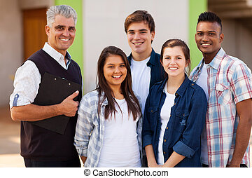 male high school teacher standing with students