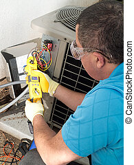 Male Hispanic air-conditioning maintenance technician