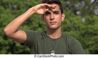 Male Hispanic Teenage Soldier Recruit Saluting