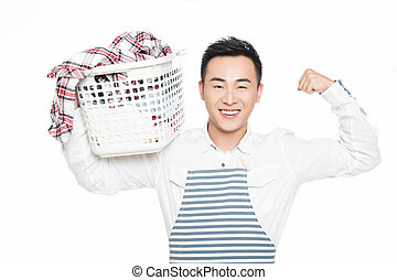 cheerful man holding a laundry basket isolated on white background