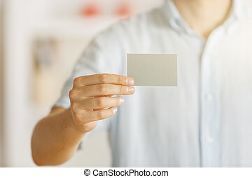 Male holding empty business card