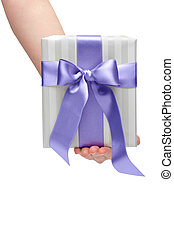 male holding gift box with a bow isolated on white background
