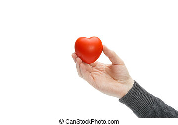 Male holding heart shaped toy in hand - studio shot