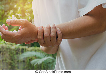 Male holding wrist. Pain in a man wrist. Man massaging painful wrist. pain concept.