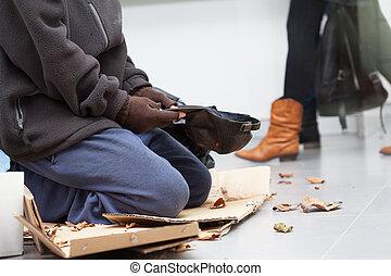 Male homeless begging