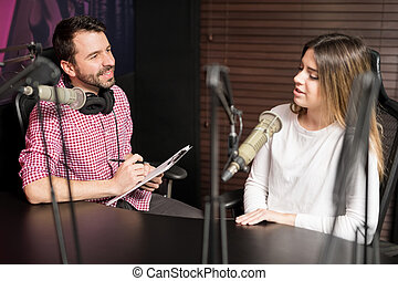 Male host interviewing a guest for podcast