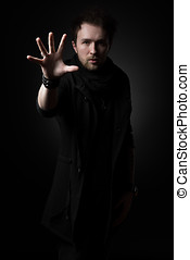 Male illusionist on a black background - Male illusionist in...