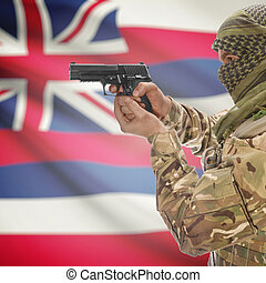 Male in muslim keffiyeh with gun in hand and flag on background - Hawaii