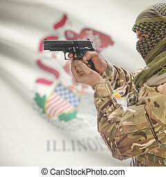 Male in muslim keffiyeh with gun in hand and flag on background - Illinois