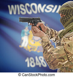 Male in muslim keffiyeh with gun in hand and flag on background - Wisconsin
