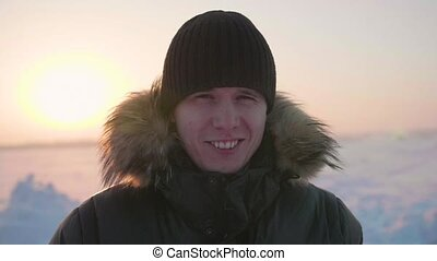 Male in winter Park smiling face closeup. Walking in the open air. A healthy lifestyle