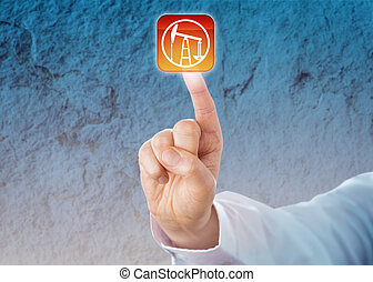Male index finger is pressing a virtual push button displaying a jack pump icon. Technology concept and business metaphor for the petroleum industry, crude oil extraction and onshore production.