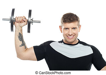 Male instructor posing with raised dumbbell