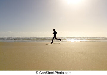 male jogging exercise in beach