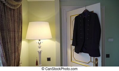 Male jacket in bedroom - Male jacket hanging in bedroom